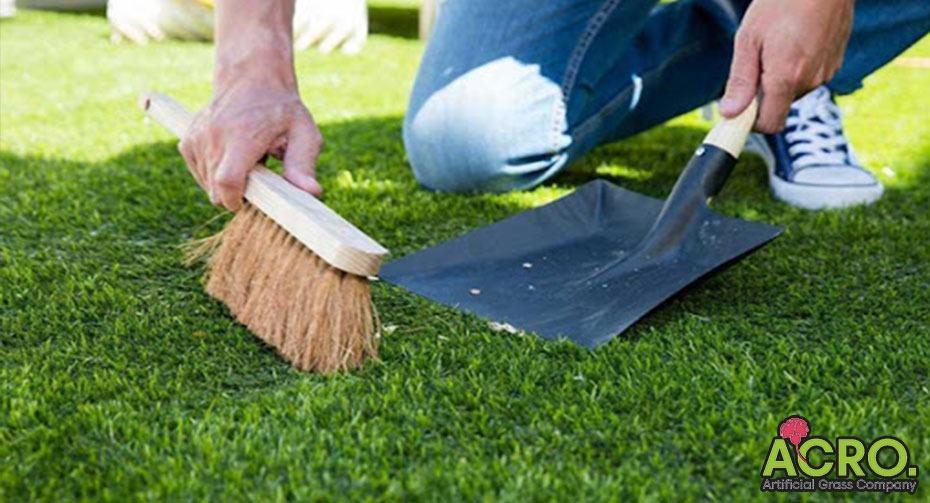 Dịch vụ vệ sinh thảm cỏ nhân tạo
